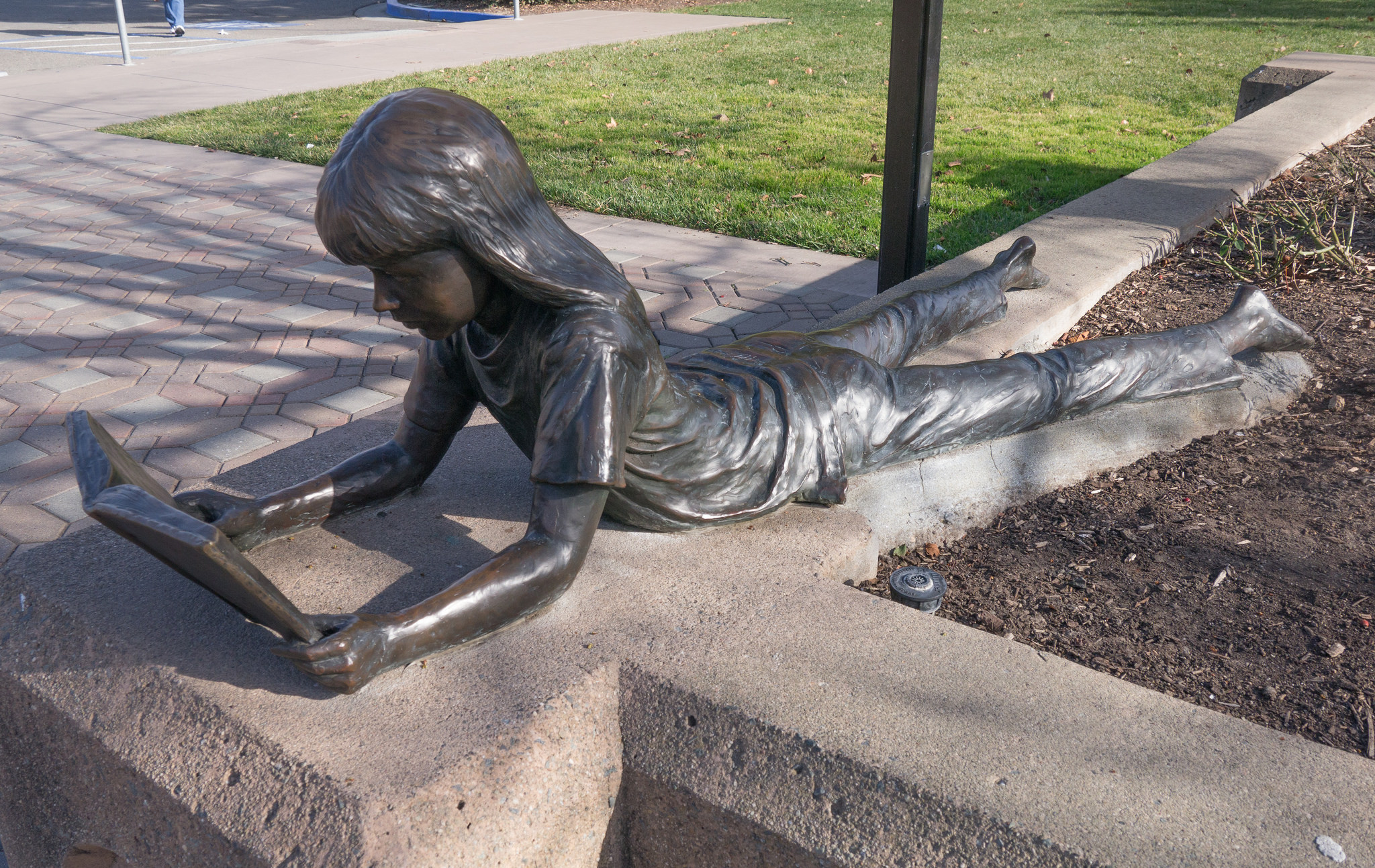 Girl Reading Book statue at library in Pleasanton, CA